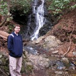 Kenny in front of a waterfall watermark